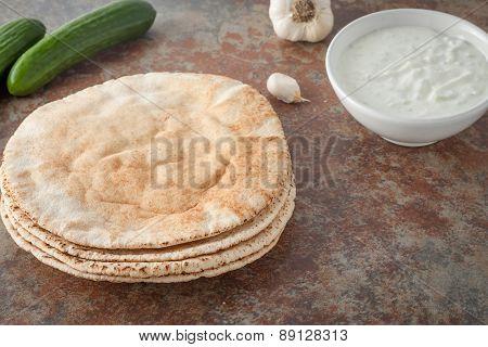 a stack of flat pita breads