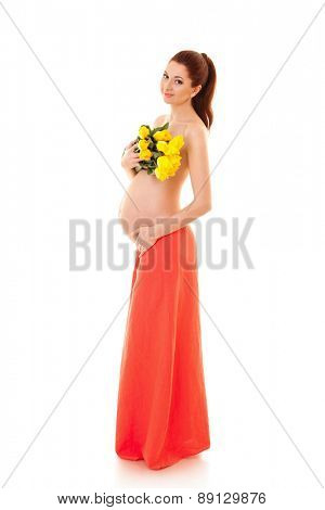 Beautiful pregnant woman with bouquet of yellow flowers on the white background