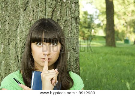 Female in a park with a notebook