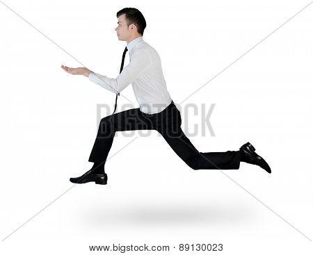 Isolated business man run holding something