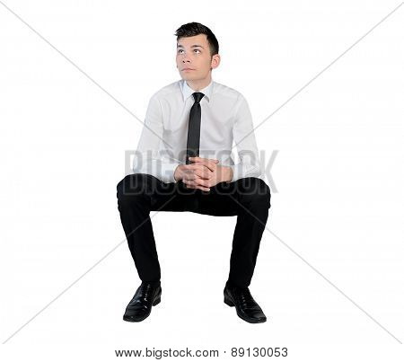 Isolated business man looking up