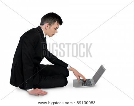 Isolated business man writing laptop