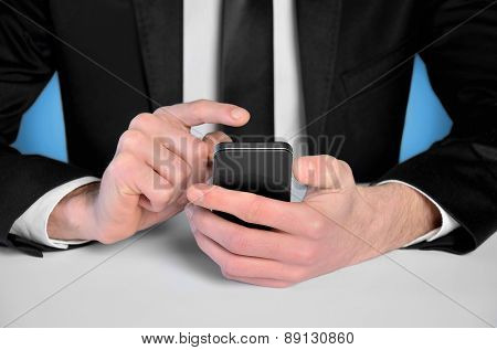 Business man with phone at desk