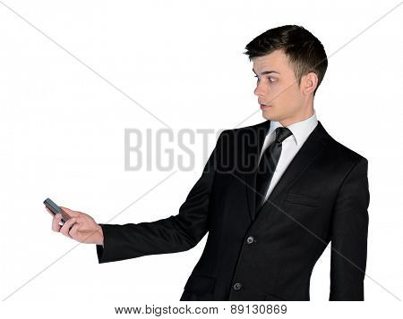 Isolated business man shocked with phone