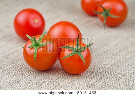 Ripe Fresh Cherry Tomatoes On Coarse Fabric