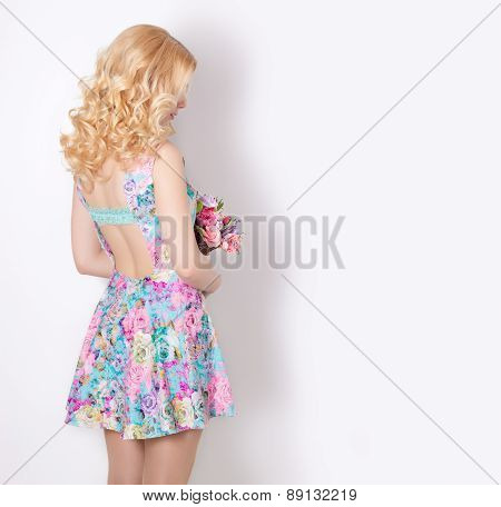 beautiful sexy modest sweet tender girl with curly blond hair standing on white background