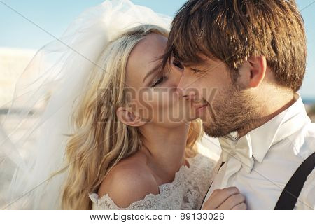 Romantic wedding couple on sea-coast
