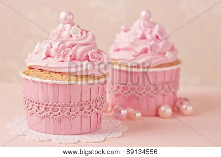 Pink cupcakes on a beige background