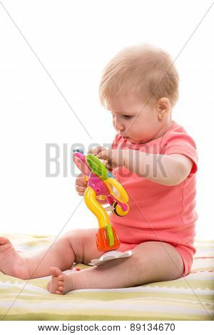 Blond Baby Girl Playing With Flower Toy