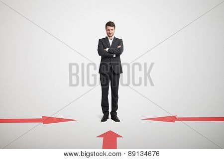 red arrows indicate at pensive businessman in formal wear over light grey background