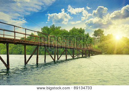 Wooden bridge over the. sunrise