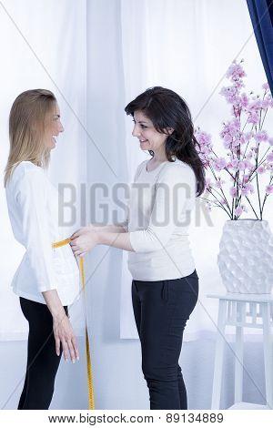 Seamstress Measuring Waist .