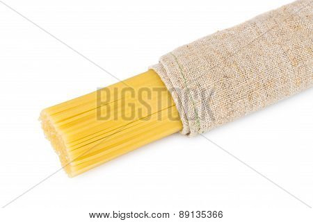 Spaghetti Wrapped In Coarse Burlap Isolated On White