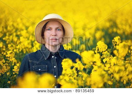 Female Farmer In Oilseed Rapeseed Cultivated Agricultural Field Beauty Portrait
