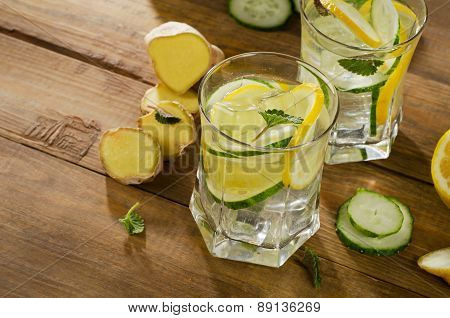 Fresh Water With Lemon, Mint , Ginger And Cucumber  On A Wooden Background.