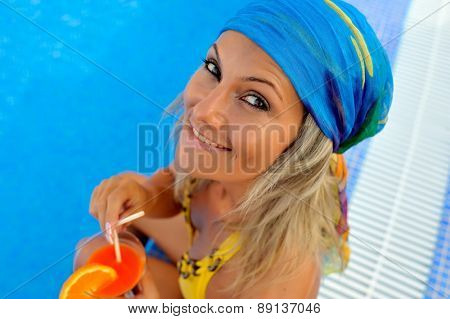 young woman at the pool on a warm summer day