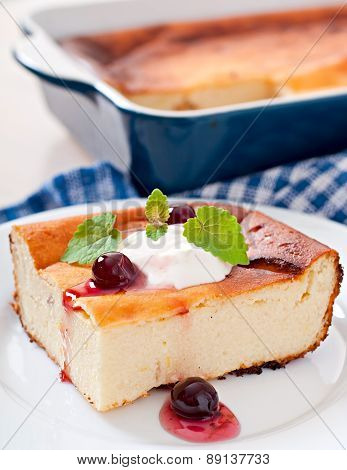 ppetizing cottage cheese casserole on white plate close up