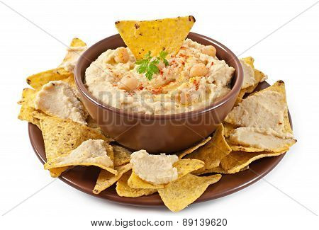 Healthy homemade hummus with olive oil and pita chips isolated on white background