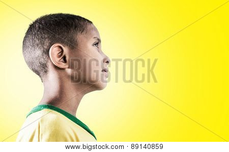 Brazilian little boy on yellow background