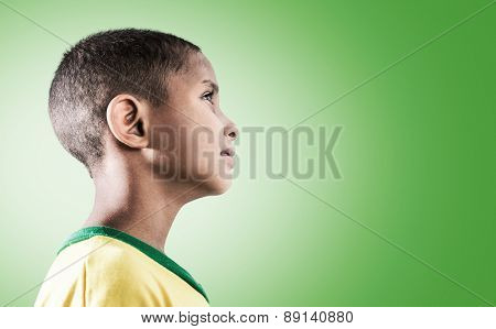 Brazilian little boy on green background