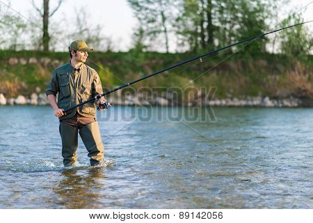Young fisherman at the river
