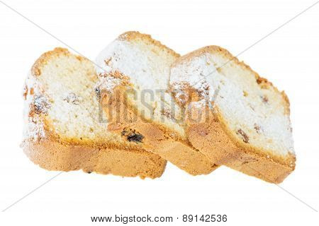 Three Slices Of Cake With Raisins