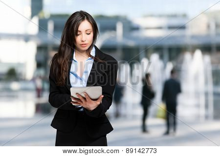 Woman using a digital tablet outdoor