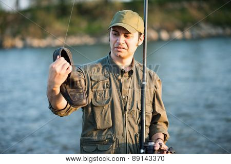 Portrait of a fisherman fishing on a river