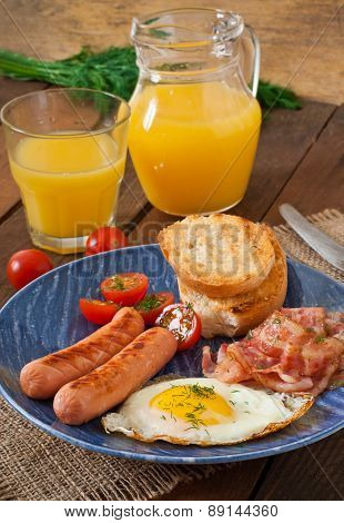 English breakfast - toast, egg, bacon and vegetables in a rustic style on wooden background