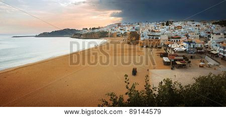 Panorama of Albufeira town and empty beach in Portugal in the evening
