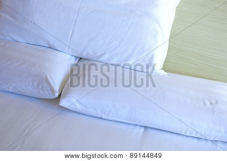closeup of white bedclothes and pillow on bed