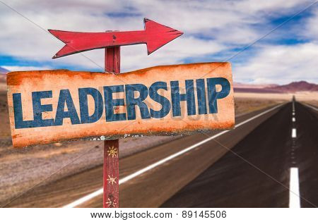 Leadership sign with road background
