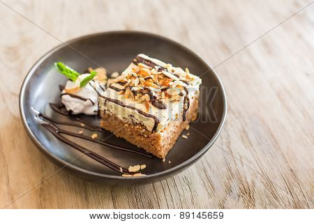 Carrot Cake With Walnuts, Prunes And Dried Apricots On A Dark Wood Background. Tinting. Selective Fo