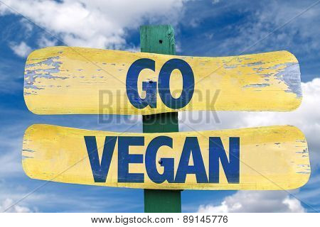 Go Vegan sign with sky background