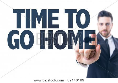 Business man pointing the text: Time to Go Home
