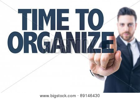 Business man pointing the text: Time to Organize