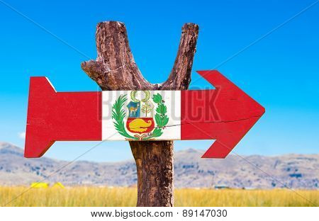 Peru wooden sign with Titicaca Lake background