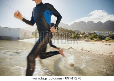 Triathletes Rushing Into The Water