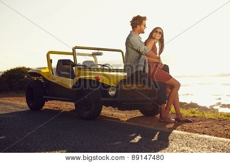 Young Couple Relaxing Together On Their Road Trip