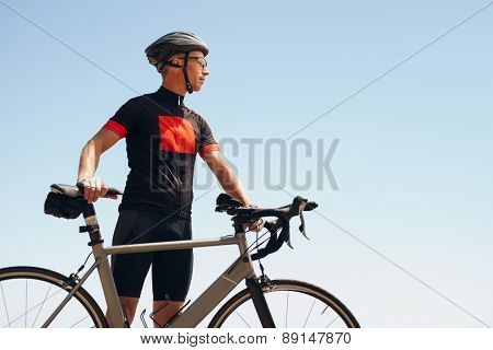 Determined Male Cyclist Looking Away