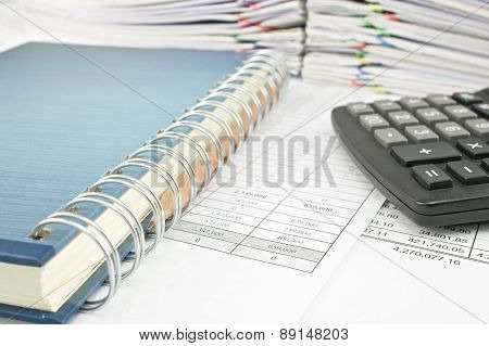 Close Up Pencil In Notebook With Calculator