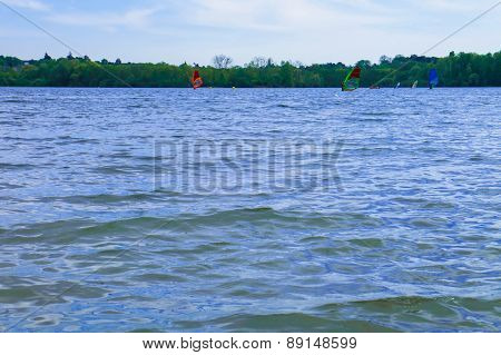 Surfers on a lake