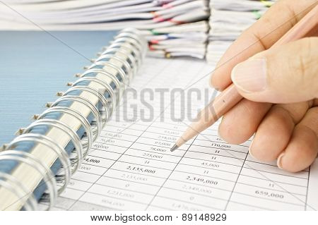 Man Is Auditing Account By Pencil With Notebook