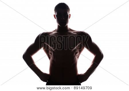 Silhouette of young athlete bodybuilder man