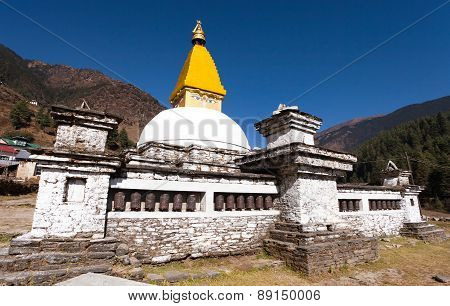 Stupa And Prayer Wheels In Junbesi Village