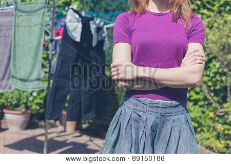 Woman With Her Laundry Outside In Garden