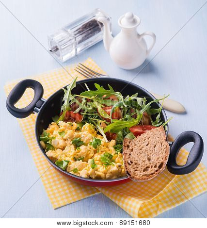 Scrambled Eggs With Fresh Salad In Frying Pan