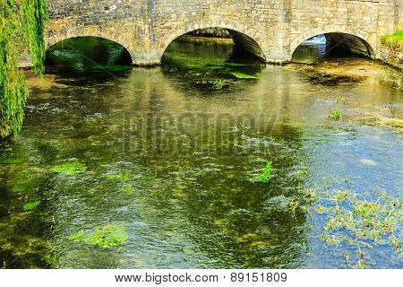 Old Bridge Over River Coln In Village Bibury England
