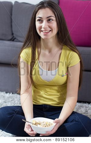 Happy Young Woman Eating Cereal Breakfast