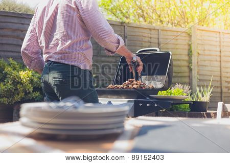 Plates On A Table Outside With Man In Background